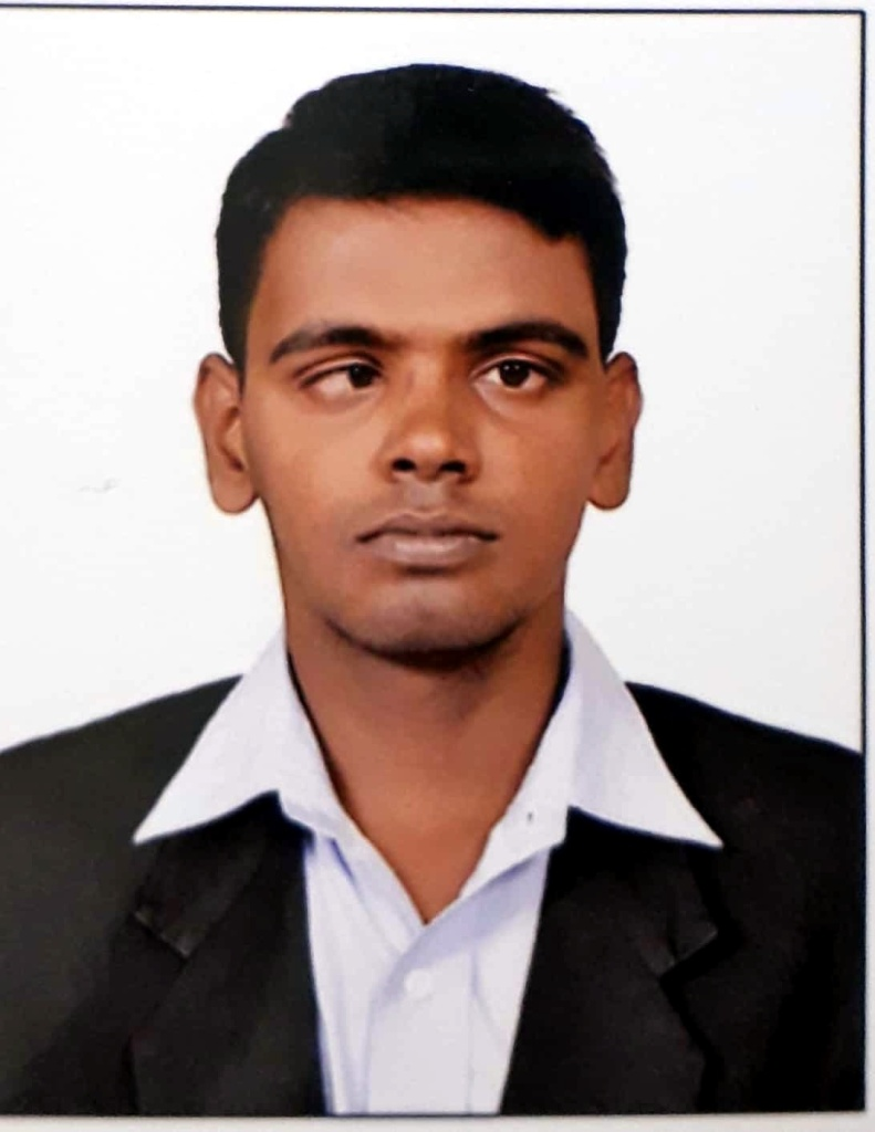 head shot of Gokul S wearing business attire in front of a white background