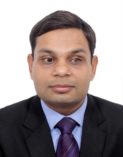 head shot of Tarun Kumar Vashisth wearing formal business satire in front of a white background